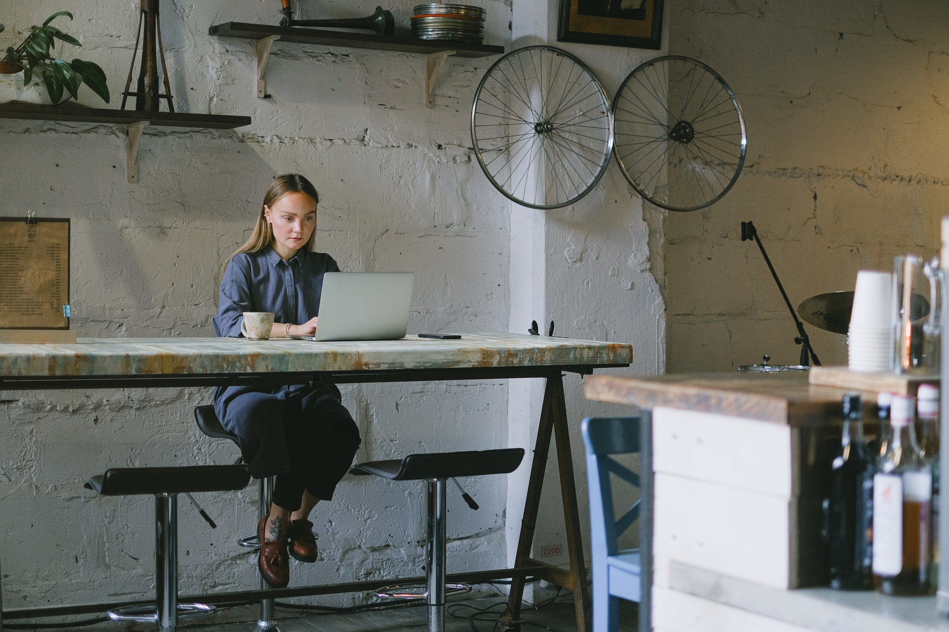 female founder sitting at laptop