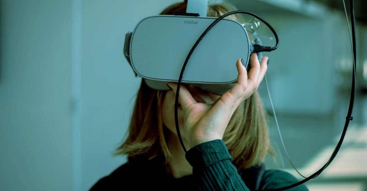 person wearing Oculus VR mask