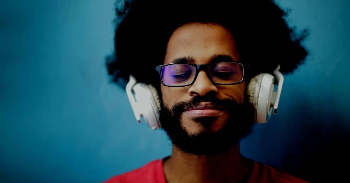 man wearing headphones listening to podcasts and music