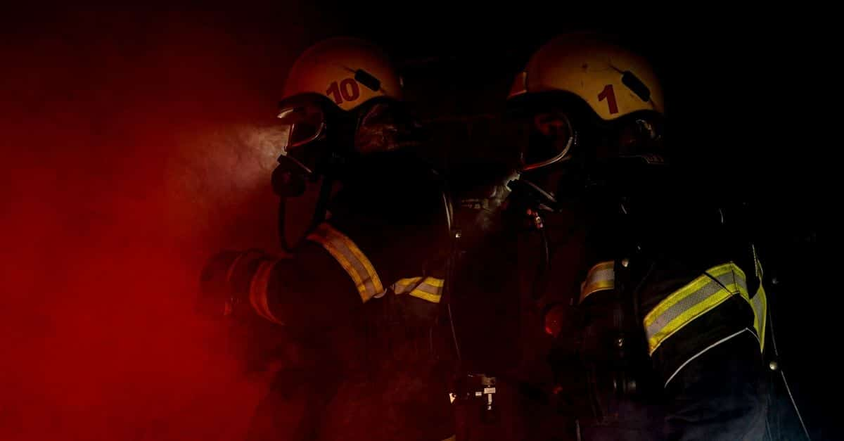 firefighters wearing their gear and going to assist with a fire